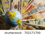 globe map sign over many... | Shutterstock . vector #702171700