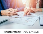 business team analyzing income... | Shutterstock . vector #702174868