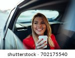 shot of a smiling young woman... | Shutterstock . vector #702175540