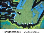 the old wall  painted in color... | Shutterstock . vector #702189013