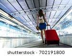 young girl traveler walking... | Shutterstock . vector #702191800