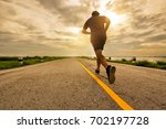 young man running on the street ... | Shutterstock . vector #702197728