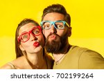 portrait of young adult couple... | Shutterstock . vector #702199264