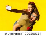 young adult hipsters. bearded... | Shutterstock . vector #702200194