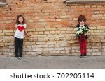 little boy and girl on the... | Shutterstock . vector #702205114