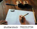 hands of a school kid doing his ... | Shutterstock . vector #702212734