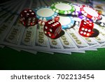 stack of poker chips with dice... | Shutterstock . vector #702213454