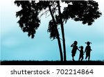 children silhouette in nature . | Shutterstock .eps vector #702214864