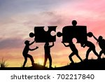 silhouette people helping to... | Shutterstock . vector #702217840