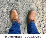 brown leather boots and blue...   Shutterstock . vector #702227269