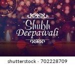 happy diwali celebrations... | Shutterstock .eps vector #702228709
