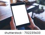 mockup image of hands holding...   Shutterstock . vector #702235633