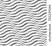vector wave pattern. geometric... | Shutterstock .eps vector #702239344