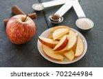 Plate Of Apple Slices On Dark...