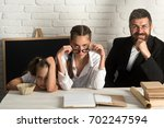 kid and her tutors with tired ... | Shutterstock . vector #702247594