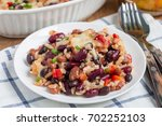 baked rice casserole with black ... | Shutterstock . vector #702252103