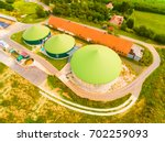 aerial view over biogas plant... | Shutterstock . vector #702259093