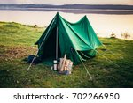 green tent standing on the... | Shutterstock . vector #702266950