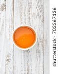 honey in bowl on white wooden... | Shutterstock . vector #702267136