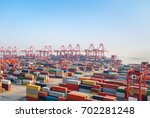 shipping container terminal at... | Shutterstock . vector #702281248