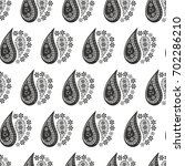 floral white and black paisley... | Shutterstock .eps vector #702286210