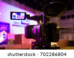 video camera and blurred in... | Shutterstock . vector #702286804