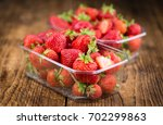 Strawberries On An Old Wooden...