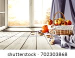autumn window with wooden table ... | Shutterstock . vector #702303868