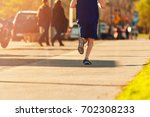 man running with shorts in a... | Shutterstock . vector #702308233