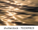 water surface with moving wave... | Shutterstock . vector #702309823
