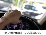 hand driver control steering... | Shutterstock . vector #702310780