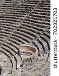 steps of ancient amphitheater... | Shutterstock . vector #702321703