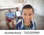 portrait of smiling boy... | Shutterstock . vector #702335989