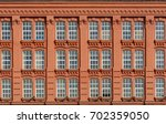 red brick classic facade of the ... | Shutterstock . vector #702359050