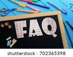 the text faq on a black... | Shutterstock . vector #702365398