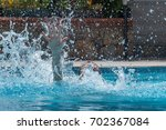 person drowns in the pool with... | Shutterstock . vector #702367084