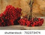 viburnum berries on the wooden...   Shutterstock . vector #702373474