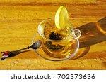 a cup of tea after a rain | Shutterstock . vector #702373636