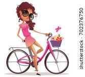 cute girl on bike | Shutterstock . vector #702376750