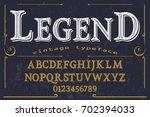 vintage font handcrafted vector ... | Shutterstock .eps vector #702394033
