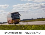 bus on the road with motion... | Shutterstock . vector #702395740