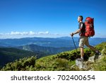 hiking in the mountains with a...   Shutterstock . vector #702400654
