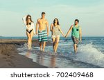group of friends together on... | Shutterstock . vector #702409468