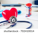 red toy heart and stethoscope... | Shutterstock . vector #702410014