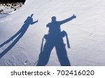 Small photo of shadows of adventurous climbers
