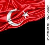 turkey flag of silk with... | Shutterstock . vector #702420004