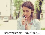 young woman having asthma... | Shutterstock . vector #702420733