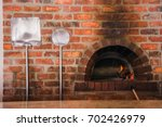 a red brick pizza oven | Shutterstock . vector #702426979