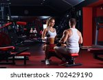 fitness couple exercising with...   Shutterstock . vector #702429190