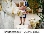 the priest sanctifies with...   Shutterstock . vector #702431368